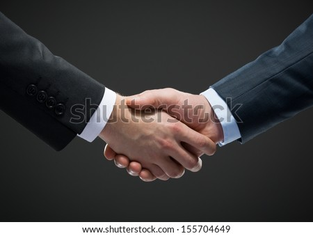 Close up view of handshake of business people. Concept of trustworthy relations and business cooperation - stock photo
