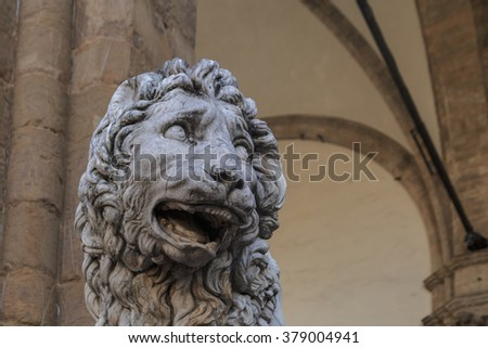 Close up view of historical granit sculptures of a lion at Piazza Della Signoria in Florence.