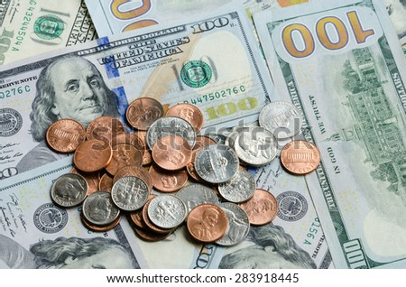 Close-up view of hundred dollars banknote and coins on white background. Panoramic style. - stock photo