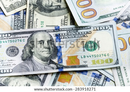 Close-up view of hundred dollars banknote on white background. Panoramic style. - stock photo