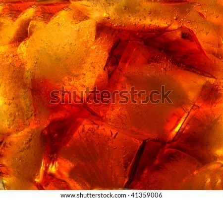 Close-up view of ice cubes in cola