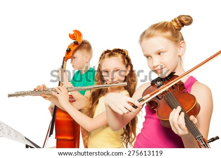 Close-up view of kids playing musical instruments - stock photo