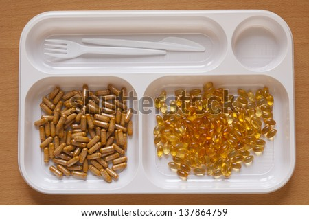 Close-up view of large number of Nutritional Supplement Tablets in a food tray. Vitamin E and Vitamin B-Complex - stock photo