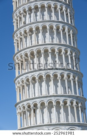 Close up view of Leaning Tower of Pisa in Tuscany, a Unesco World Heritage Site and one of the most recognized and famous buildings in the world. - stock photo