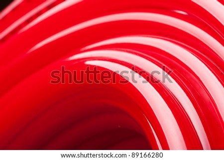 Close-up view of long red water pipe - stock photo