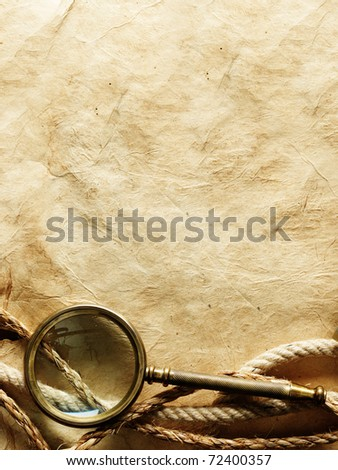 Close up view of magnifier and rope on vintage paper