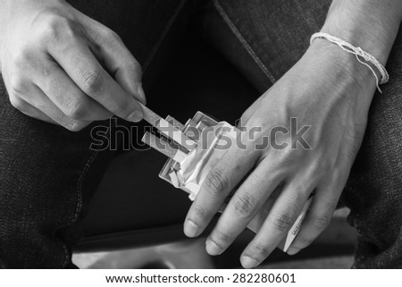 Close-up view of male hand take a cigarette from the pack