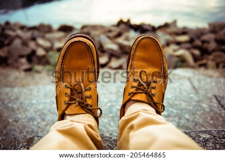 close-up view of man's leather top sider shoes - stock photo