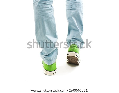 Close-up view of man's legs in vintage green shoes from the back. Isolated on a white background - stock photo