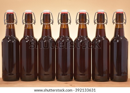close-up view of many beer bottles with clip closure - stock photo