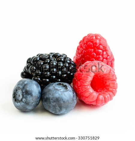 Close-up view of mixed, assorted berries blackberry, strawberry, blueberry, raspberry isolated on white background. Colourful and healthy concept. Black, blue, red, green color, copy space - stock photo