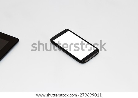 Close up view of mobile phone with blank white screen, isolated on white background. - stock photo