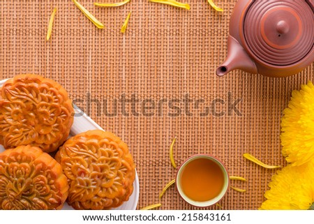 Close up view of Moon cake and tea pot. Chinese mid autumn festival food. Above angle - stock photo