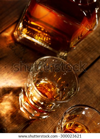 close up view of  nice bottle and two glasses filled with whiskey  - stock photo