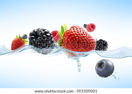 close up view of nice fresh berries on blue background - stock photo