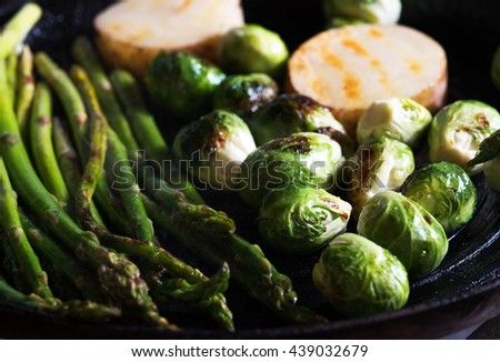 close up view of nice fresh vegetables is being fried