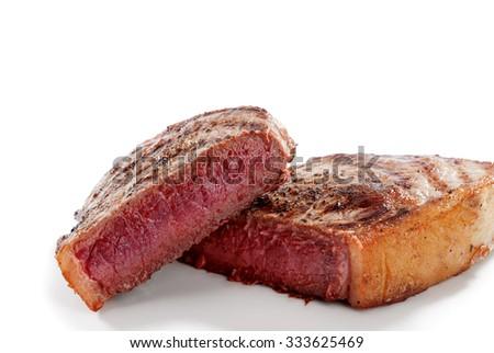 close  up view of nice yummy fresh steak on white back - stock photo