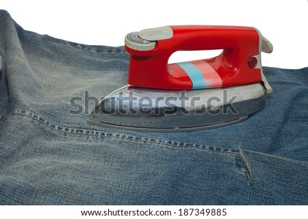 close up view of  old iron on cloth. - stock photo