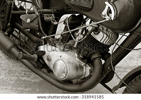 Close up view of old motorcycle engine. Grunge - stock photo