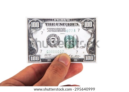 Close up view of one hundred dollar banknote, holding on hand, isolated on white background. - stock photo
