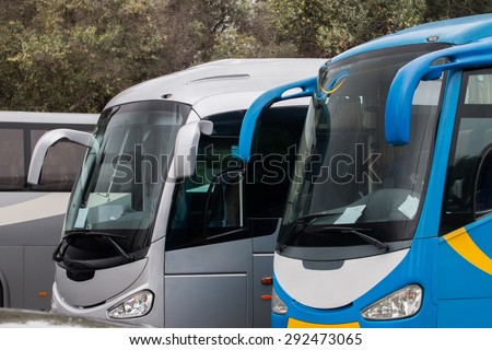 Close up view of parked tour buses in Lisbon - Portugal. - stock photo