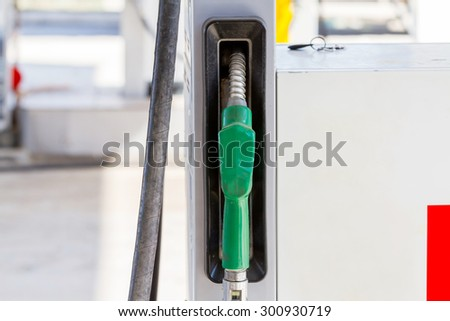 Close-up view of petrol pump in a petrol station - stock photo