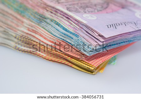 Close-Up View of Pile of Australian Banknotes Different Denominations - stock photo