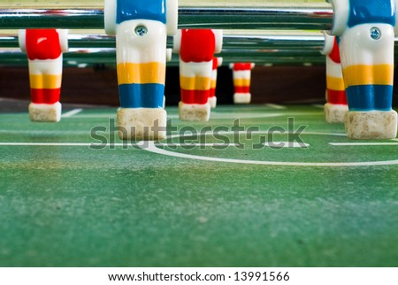 Close up view of plastic players in a football table - stock photo