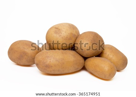 Close up view of potatoes isolated on a white background. - stock photo