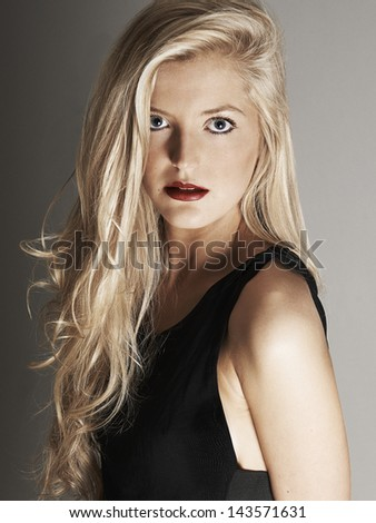 Close-up view of pretty blonde woman looking at camera - stock photo