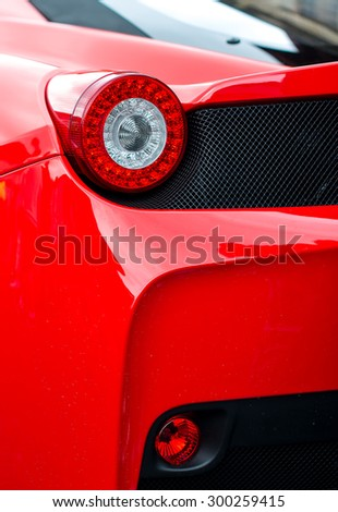 Close-up view of red sports car rear light.