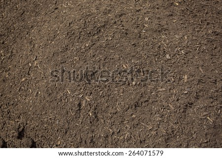 Close up view of rich, healthy compost dirt ready to be put into a garden and help grow healthy vegetables - stock photo