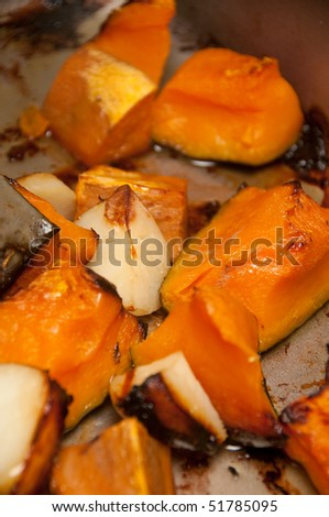 close up view of roast pumpkin and roast potatoes