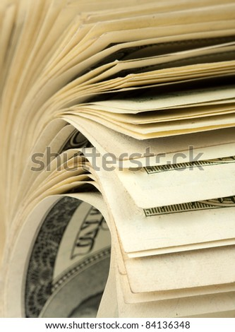Close-up view of roll of $100 bills - stock photo