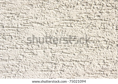 Close up view of scratchy cement wall - stock photo