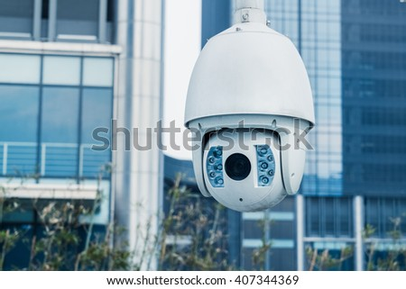 close-up view of security camera,in front of office building. - stock photo