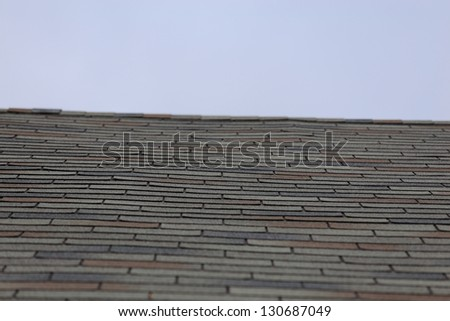Close up view of shingles on a roof - stock photo
