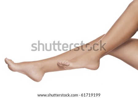 close up view of smooth womanâ??s legs on white background - stock photo