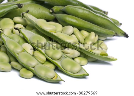 Close up view of some broad beans isolated on a white background. - stock photo