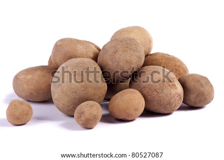Close up view of some potatoes isolated on a white background.