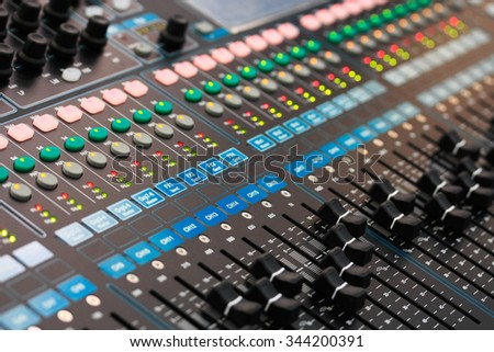 Close up view of sound mixing console. Selective focus. - stock photo
