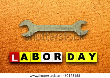 Close up view of spanner on wood board,labor day - stock photo