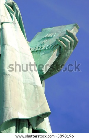 Close up view of stone tablet held by Statue of Liberty commemorating the American Declaration of Independence. - stock photo