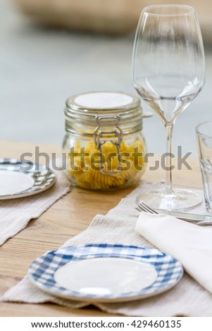Close-up view of table setting in Italian restaurant - stock photo