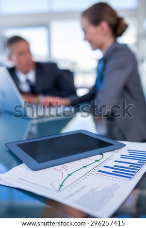 Close up view of tablet computer with document in office - stock photo