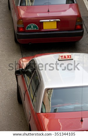 Close-up view of taxis on a road in Hong Kong