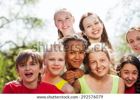 Close-up view of teenagers diversity sitting close - stock photo
