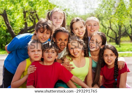 Close-up view of teenagers sitting and hugging - stock photo