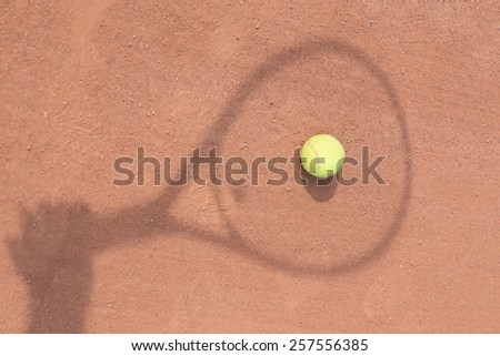 Close up view of tennis racket and balls on the clay tennis court - stock photo