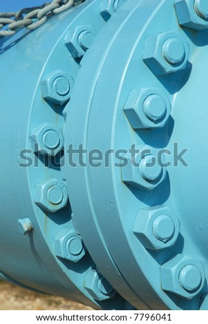 Close-up view of the bolt use to secure the pipeline connections. - stock photo